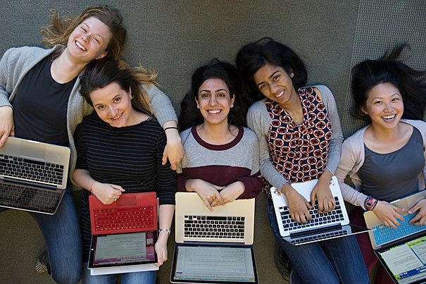 "Emi Nietfeld '15 (from left, photo 1), Ana-Maria Constantin '16, Amna Hashmi '16, Ramya Rangan '16, and J.N. Fang '16 are members of Harvard Women in Computer Science, which promotes women in the male-dominated field. ""They're getting to the heart of some of the challenges,"" said Margo I. Seltzer (photo 2), Herchel Smith Professor of Computer Science at SEAS, who, along with Radhika Nagpal (far right, photo 3), the Fred Kavli Professor of Computer Science, advises the group."