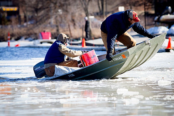 Assistant coaches Patrick Lapage (bow) breaks up ice on the Charles with Ian Accomando.