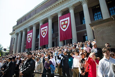 Although seating will be limited at Harvard's 364th Commencement, the steps of Widener Library (pictured) and the rear and sides of Tercentenary Theatre provide additional options for viewing the exercises.