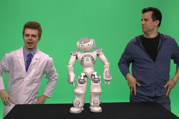 """David Malan (right), Gordon McKay Professor of the Practice of Computer Science, technologist Colton Ogden from CS50/CS50x, and a special robotic guest incorporated live broadcasts into their MOOC, """"Introduction to Computer Science."""""""