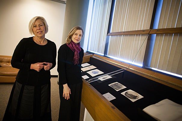 """Elena Bulat (left) and Melissa Banta are the curators of """"We Carry With Us Precious Memorials,"""" on view through May 29 in  Pusey Library."""