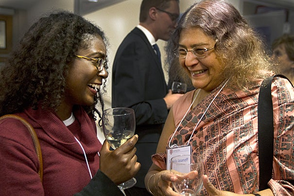 At the reunion for Environmental Science and Public Policy graduates, Nicole Maywah (left), Class of 1997, mingled with Sheila Jasanoff, Pforzheimer Professor of Science and Technology Studies at the Harvard Kennedy School.