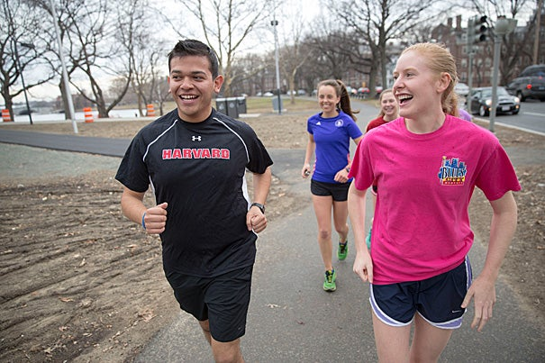 Miguel Perez-Luna '15, who is organizing a bus that will take members of the Harvard community to the starting line in Hopkinton, often trained on a treadmill during the winter months. Anna Dolan '15 also hit the treadmill at the Malkin Athletic Center. Recently the pair connected with members of the Harvard College Marathon Challenge for an outdoor run along the Charles River, minus the snow.