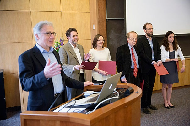Douglas Melton (from left) presented Star Family Challenge awards to five Harvard faculty: Joshua Greene, Paola Arlotta, Federico Capasso, David Keith, and accepting for Daniel Schrag was research assistant Lauren Benson Kuntz.