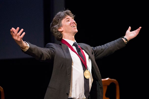 Damian Woetzel exults after being awarded the Harvard Arts Medal by President Drew Faust.