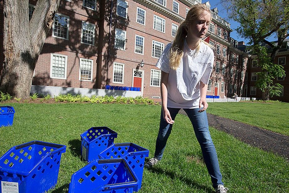 Dorm crew worker Victoria Jones '17 hoses down recycling bins outside LEED platinum-certified Stone Hall at Quincy House, the first building to be renovated as part of the House Renewal initiative.  Kris Snibbe/Harvard Staff Photographer