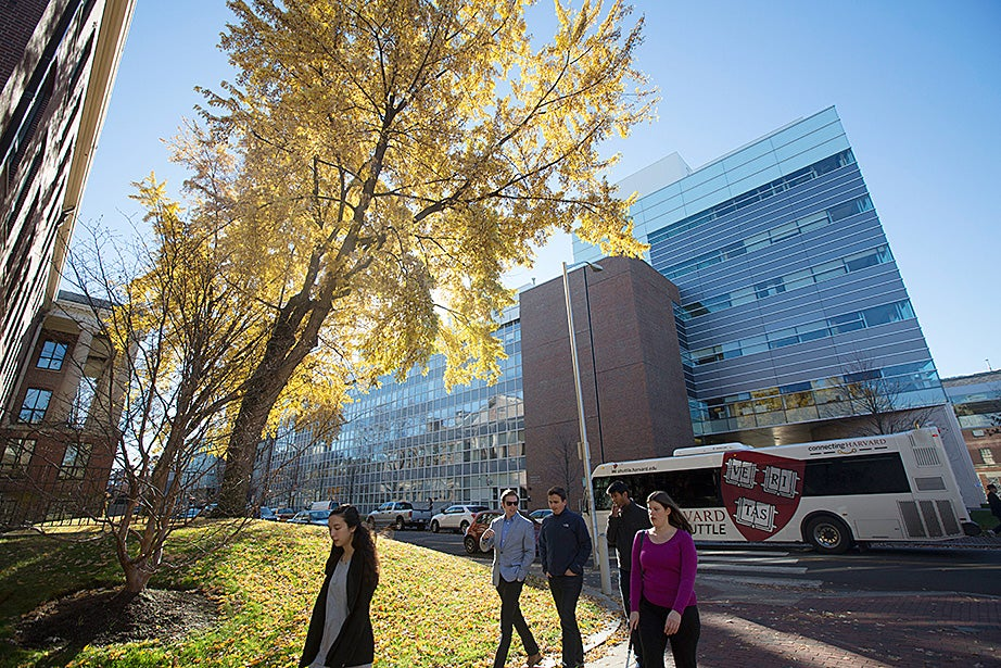 A Harvard shuttle, fueled by biodiesel, passes by the LISE building and Mallinckrodt Lab (far left). Energy-efficiency measures at the LISE building have saved more than $3.15 million since 2009. Kris Snibbe/Harvard Staff Photographer