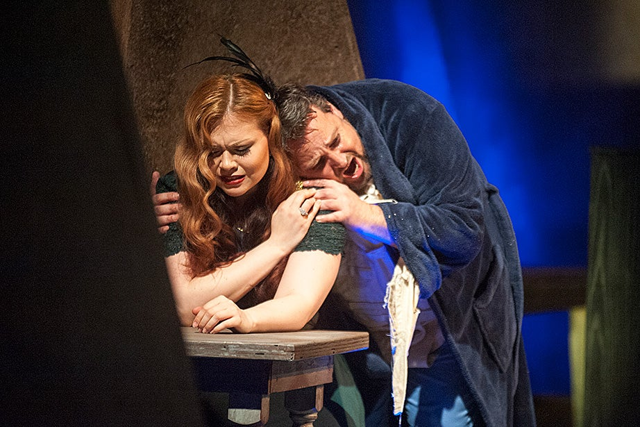 Samantha Schmid, as Liza, and Mikhail Urusov, as Gherman, are wrapped in an anguished embrace.