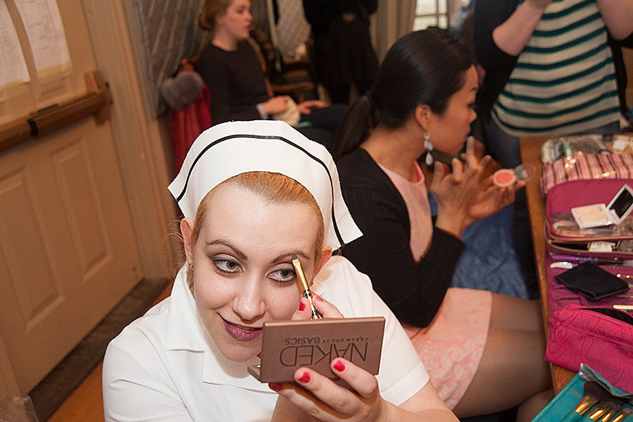 Mariya Shoteva, a native of Sofia, Bulgaria, who is finishing her master's degree in voice and opera at the New England Conservatory, applies makeup in the dressing room before the performance.