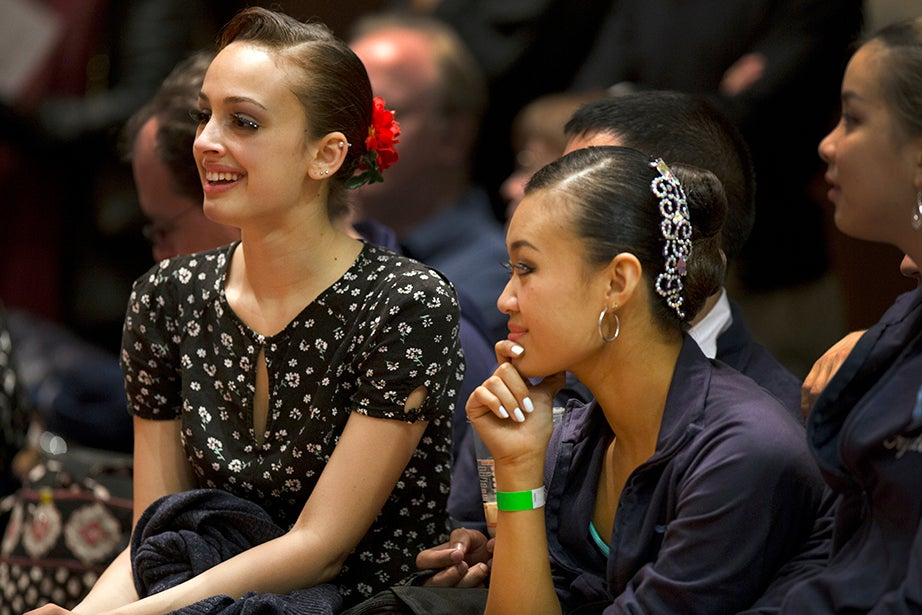 Agnes Carlowicz and Feifei Kong of Columbia University watch other dancers compete.