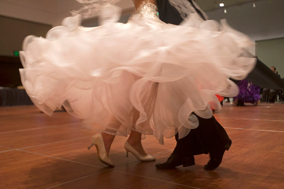 The bottom of a dancer's dress fans out as she twirls.