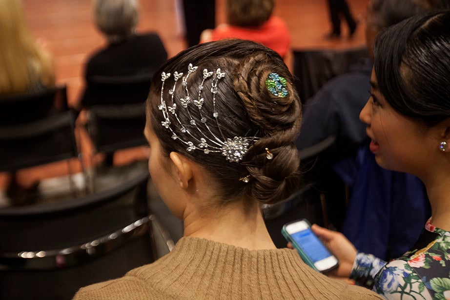 Many of the female dancers wear intricate hair styles with sparkly decorations for competitions such as this.