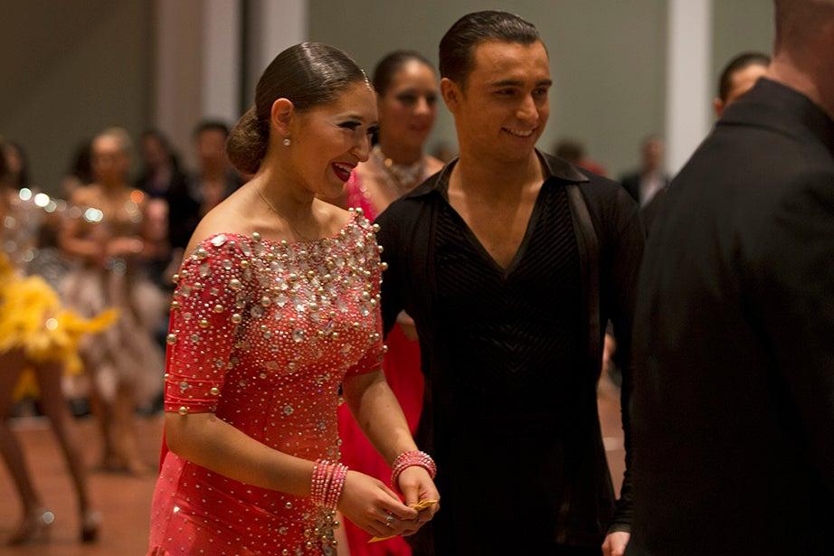 Harvard's Danielle Muchnik and Giorgio Gaglia are awarded a third-place prize for championship Latin.