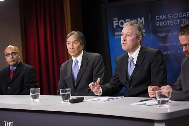 """I'm concerned about a new generation embracing e-cigarettes and undermining the gains we've made in tobacco control,"" said Vaughan Rees, interim director, Center for Global Tobacco Control, Harvard T.H. Chan School of Public Health. Debating the e-cigarette regulation at the Harvard Chan School forum were K. ""Vish"" Viswanath (from left), Howard Koh, and Rees, with moderator Scott Malone."