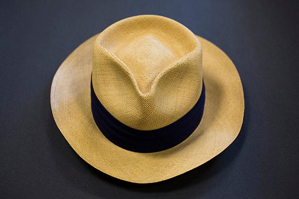 A straw Panama hat bought at the Harvard Coop by T.S. Eliot. The $5 price tag is still affixed. (Houghton Library)