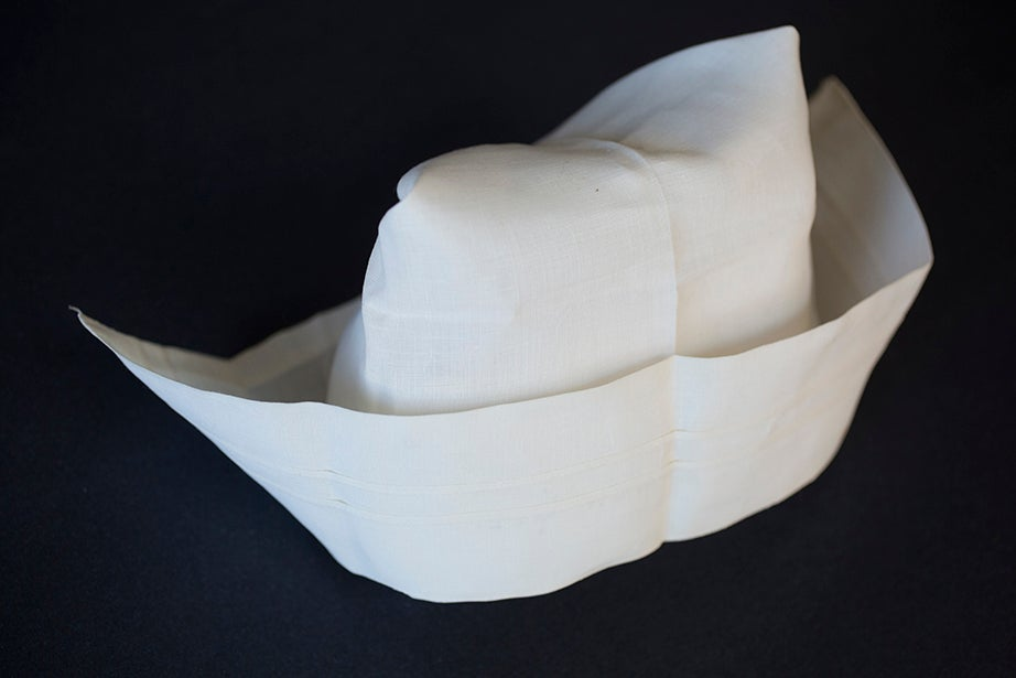 A nurse's cap with pins and buttons, circa 1930, from the collection of nursing theorist Hildegard E. Peplau. (Schlesinger Library)