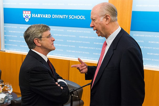 Professor David Gergen (right) told a Harvard Divinity School audience that it was important not to overstate the impact of religion on the decisions of the chief executives for whom he had worked, yet he marveled at the influence that the Rev. Billy Graham has had over presidents since Harry Truman. Gergen spoke with HDS Dean David N. Hempton (left) during the wide-ranging conversation on Friday.