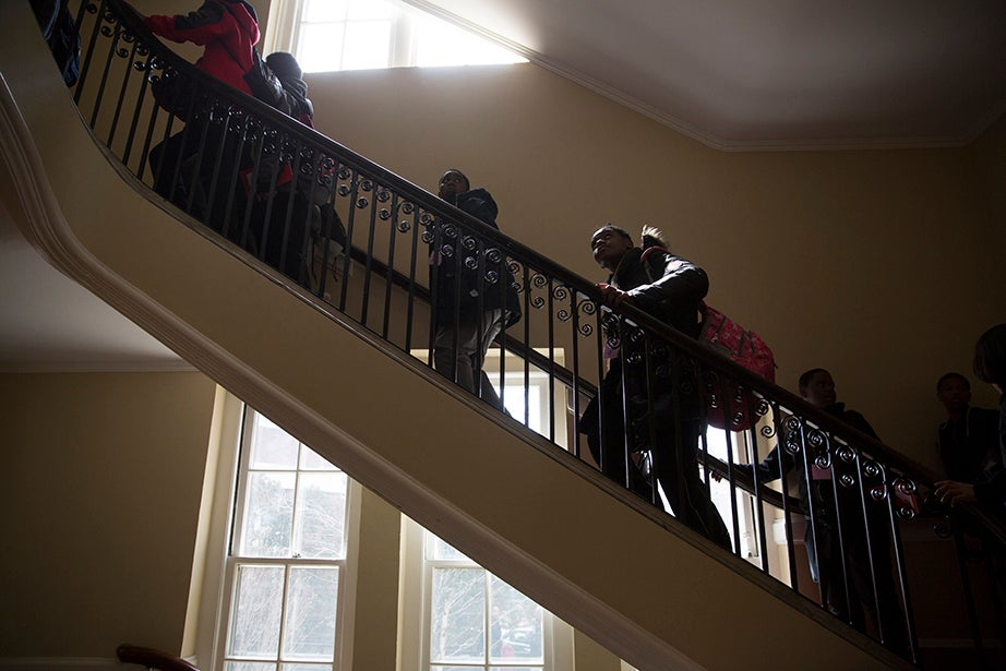 Scholars climb the stairs to Agassiz Theater to hear Harvard College Dean Rakesh Khurana speak. Rose Lincoln/Harvard Staff Photographer