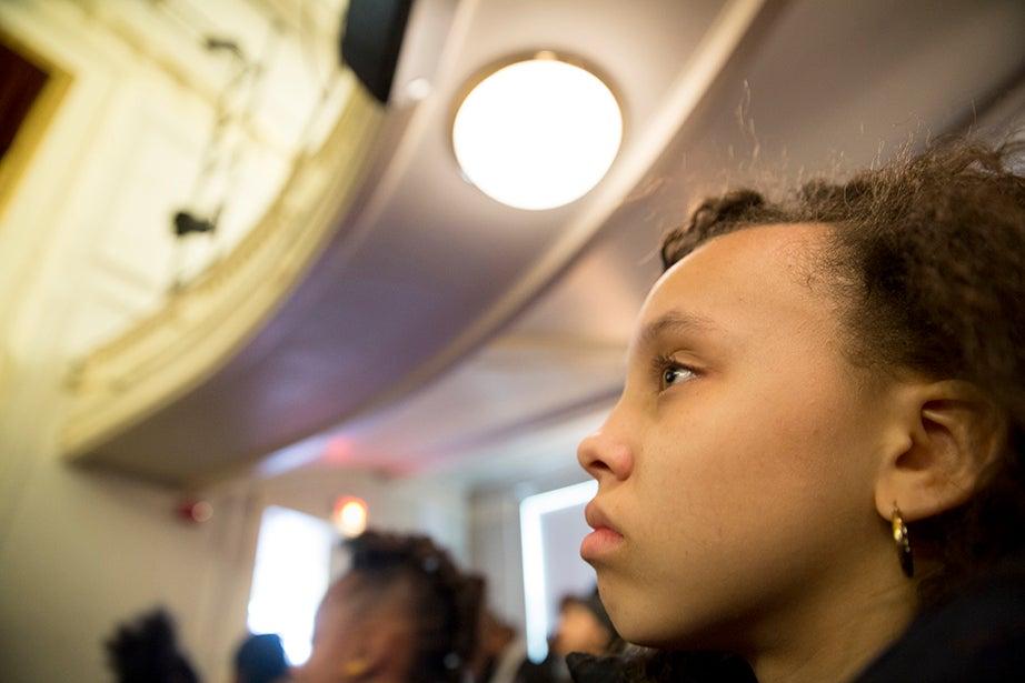 Sixth-grader Kayla Speller listens to a talk by Harvard College Dean Rakesh Khurana. Rose Lincoln/Harvard Staff Photographer