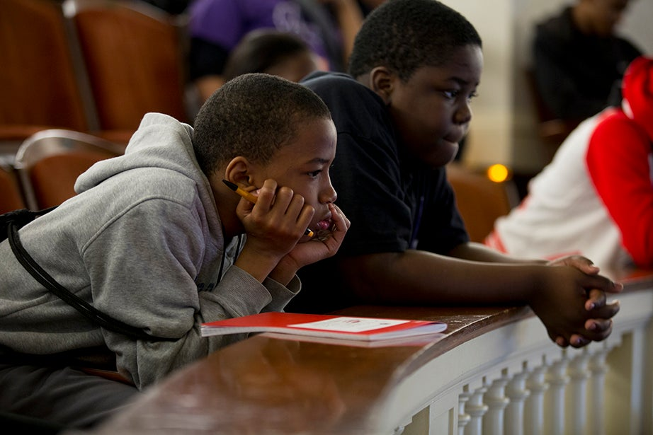 Davon Mahki and Micah Witherspoon, sixth-graders from Mott Hall Bridges Academy, are pictured inside Agassiz Theater. Rose Lincoln/Harvard Staff Photographer