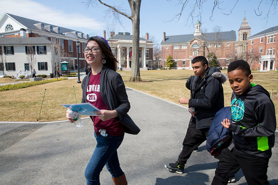 Alice Hu '18 leads a group of Mott Hall Bridges Academy scholars on a tour starting in Radcliffe Yard. Rose Lincoln/Harvard Staff Photographer