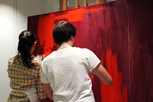 "To better understand Rothko's work, the basis for the play ""Red,"" Harvard students created a mural (photo 1) from frame to finished work. As part of the process they mixed paints similar to what Rothko had originally used (photo 2). Director Max McGillivray '16 (photo 3) prepared the set and props in Menschel Hall, where the play will be performed."