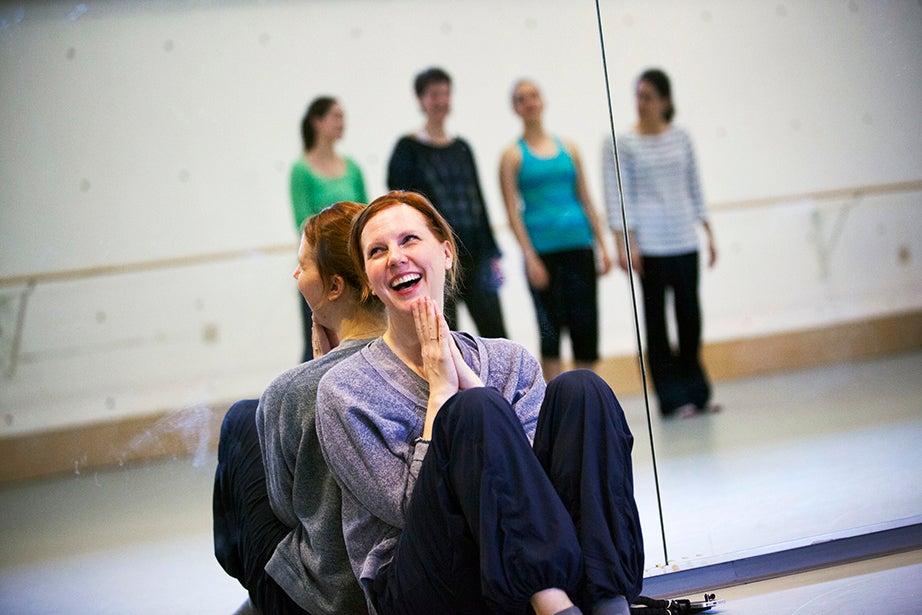 Jill Johnson applauds a student dance during rehearsal. Stephanie Mitchell/Harvard Staff Photographer