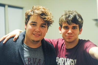 "Freshman Matthew DeShaw (right, photo 1) took a selfie with Lucas Delgado, one of the students attending Visitas. DeShaw helped to welcome the incoming freshmen at the Barker Center's Arts Café (photos 2, 3) and answered questions about a humanities concentration. ""The single most common and relevant question I fielded was, 'What are my employment options after graduating with a humanities concentration?' "" DeShaw's response: ""Whatever you want to do."""