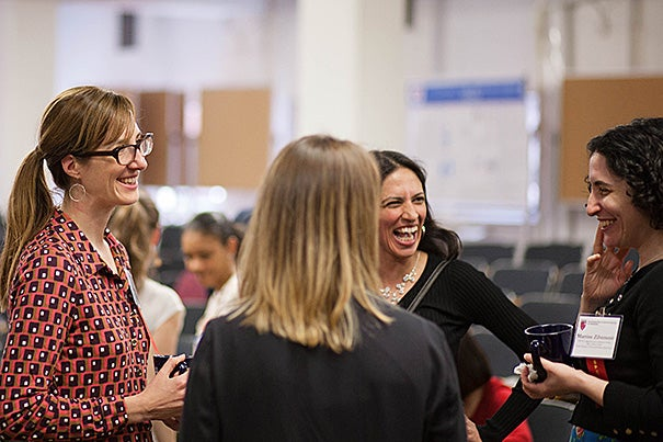 "Sarah Boyer (left) and Martine Zilversmit (right), co-founders of Harvard Graduate Women in Science and Engineering, speak with Harvard Professor Radhika Nagpal (center) during the ""WISE Beyond Your Years"" symposium."
