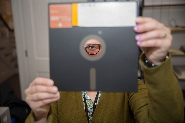 Changing with the times as the world moves from paper to digital, the Harvard Library has adopted forensic techniques to save material stored on obsolete formats. Jennifer Weintraub, a digital archivist and librarian at Schlesinger Library, eyes a floppy disk (photo 1), a format many of today's College students have never even seen. Even the technology to retrieve the data must be preserved (photo 2). Some of the formats (photo 3) require a Zip drive — yet another relic to preserve.