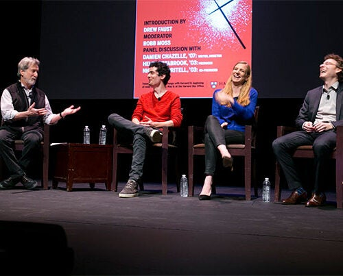 """Professor of Visual and Environmental Studies Robb Moss (from left) interviewed """"Whiplash"""" writer and director Damien Chazelle '07 and co-producers Helen Estabrook '03 and Nicholas Britell '03 about the success of their low-budget film that became an Oscar-winning hit."""