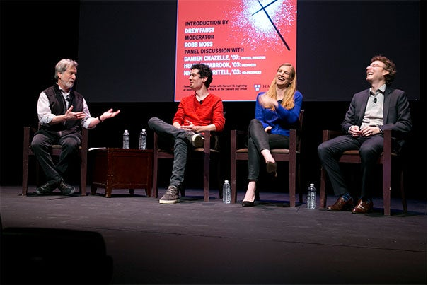"Professor of Visual and Environmental Studies Robb Moss (from left) interviewed ""Whiplash"" writer and director Damien Chazelle '07 and co-producers Helen Estabrook '03 and Nicholas Britell '03 about the success of their low-budget film that became an Oscar-winning hit."
