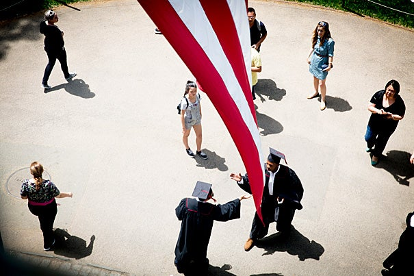 "Students greeted each other under the flag at University Hall (photo 1)  before jubilantly (photo 2) entering the Memorial Church for the Baccalaureate Service. Plummer Professor of Christian Morals and Pusey Minister Jonathan Walton (photo 3) served as host, and reminded the graduating seniors that this week is called Commencement not because it's the end of their college careers, but because it is ""only the beginning."""