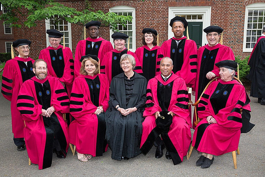 President Drew Faust (center, in black) and Harvard Provost Alan Garber (front row, far left) pose with this year's honorary degree recipients: (front row, from left) Renée Fleming, Gov. Deval Patrick, Svetlana Alpers, Robert Axelrod (back row, left to right), William Brocker, Denis Mukwege, Patricia Graham, Linda Buck, Bryan Stevenson, and Peter Salovey. Jon Chase/Harvard Staff Photographer