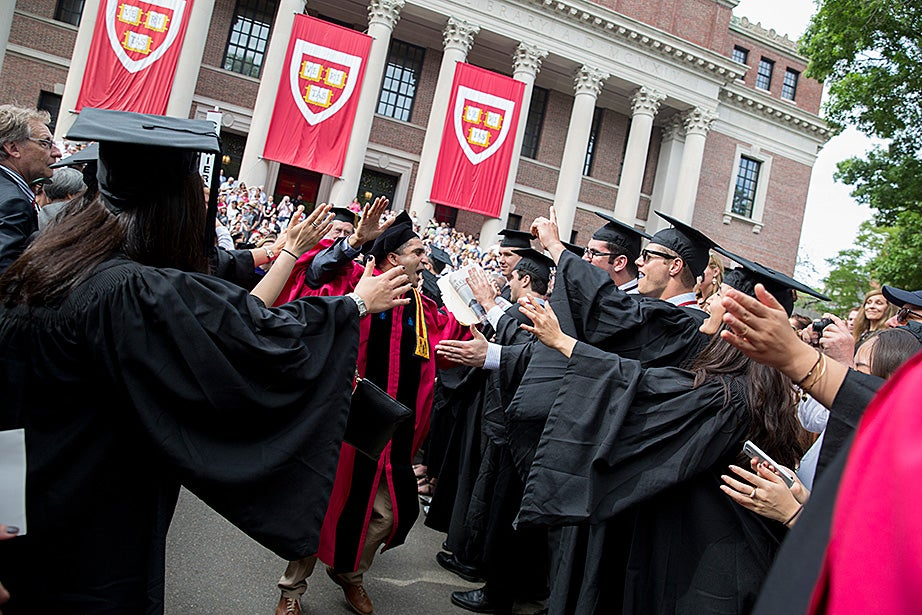 Danoff Dean of Harvard College Rakesh Khurana walks through graduates. Rose Lincoln/Harvard Staff Photographer