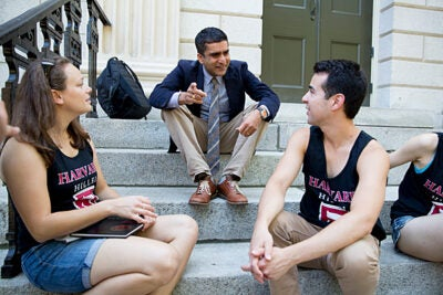 "Harvard College Dean Rakesh Khurana is pictured on freshman move-in day with students on the steps of University Hall. ""I think this year has been a time of active discussion about how we create a more inclusive Harvard community,"" Khurana said."