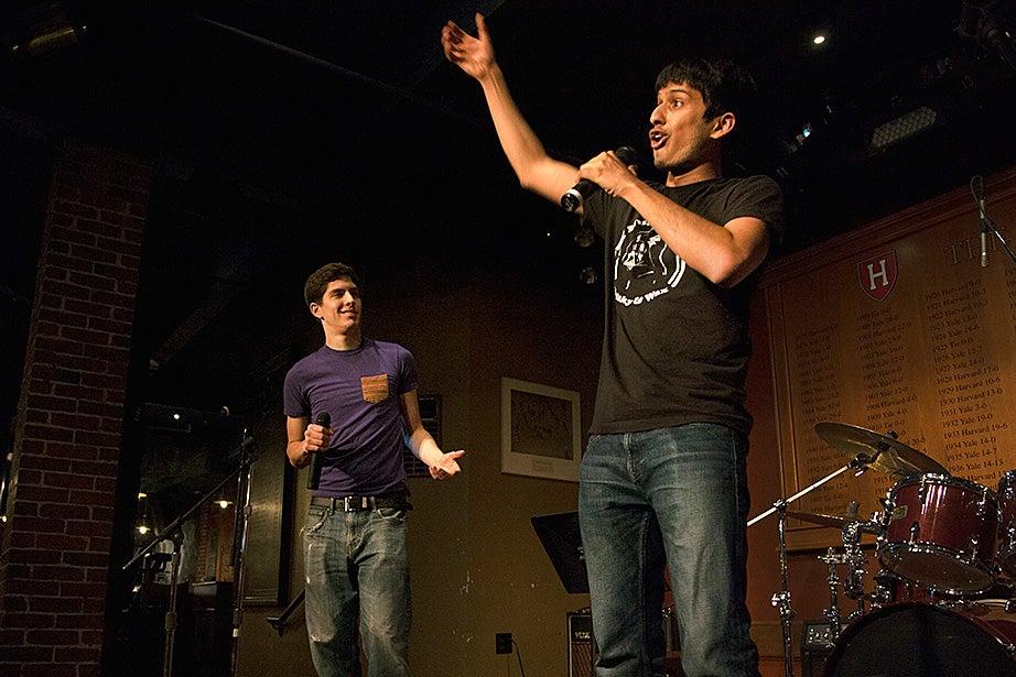 Will Corbett '16 (left) and Advik Shreekumar '16 rap original songs during a performance at Arts First. Photo by Kiera Blessing