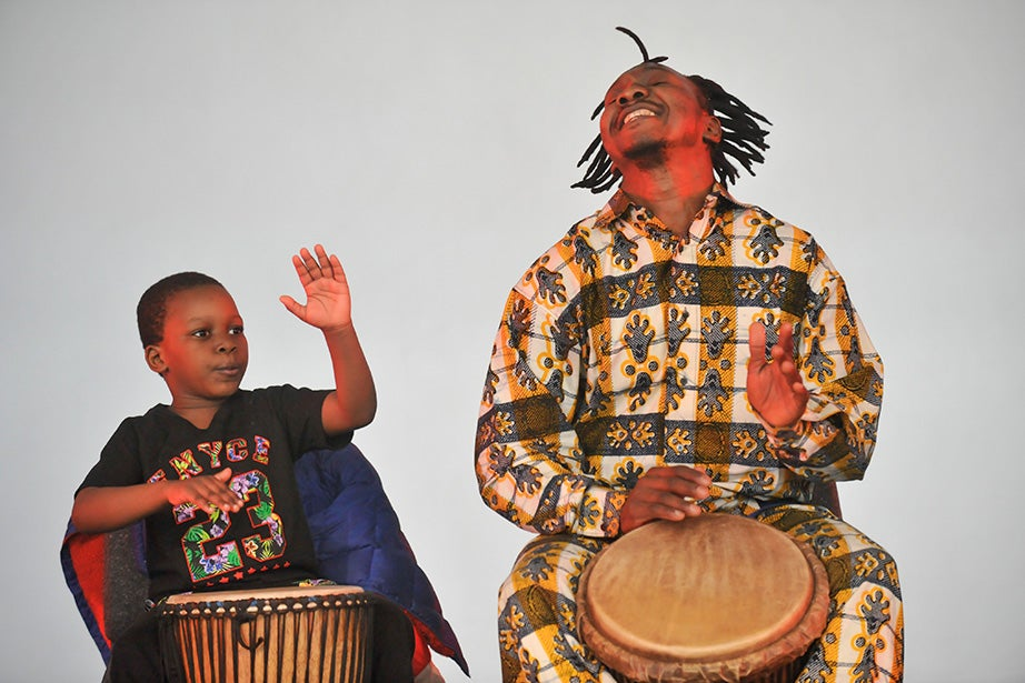 A father and son from the Pan-African Dance and Music Ensemble perform. Jon Chase/Harvard Staff Photographer