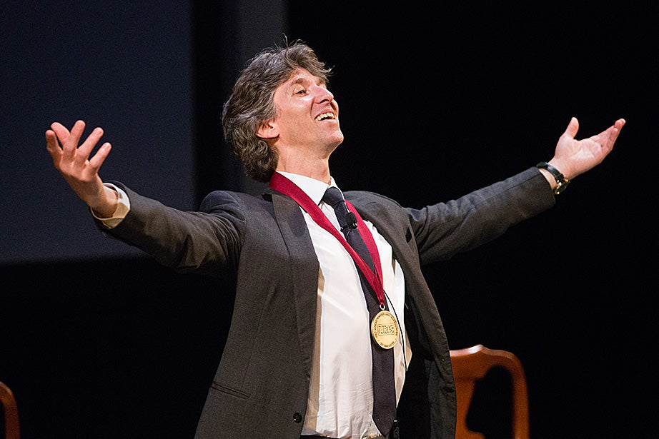 Ballet dancer, director, and arts leader Damian Woetzel exults after being awarded the Harvard Arts Medal by President Drew Faust. Jon Chase/Harvard Staff Photographer