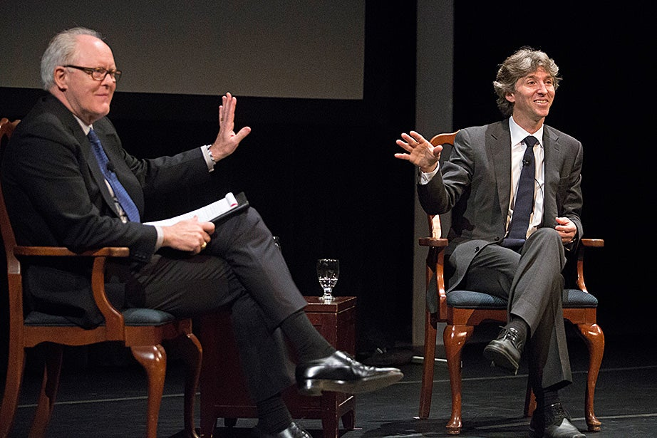 Harvard Arts Medal recipient Damian Woetzel (right) reacts to a question from John Lithgow during an interview at the award ceremony. Jon Chase/Harvard Staff Photographer
