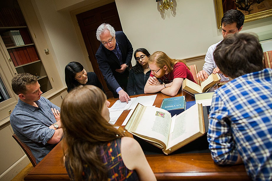 Stephen Greenblatt and Louis Menand lead students to the seminar room of Houghton Library to see some of the treasures from the collections. Charlie Gibson '18 (from left), Jane Chung '15, Menand, India Patel '18, Mitchell Edwards '18, and Archie Stonehill '17 examine a typescript of an unpublished play by Samuel Beckett from the 1950s. Stephanie Mitchell/Harvard Staff Photographer