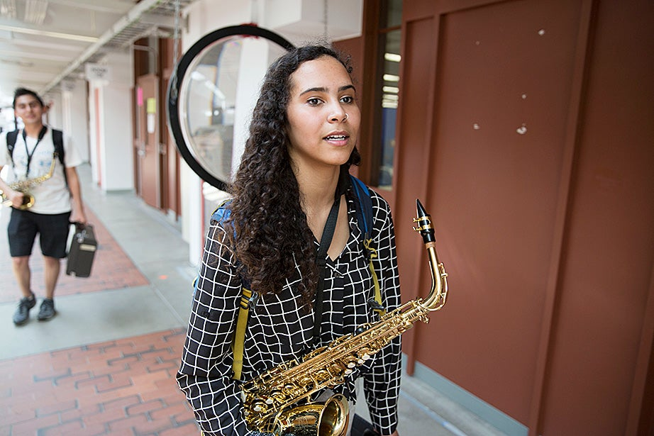 Mariah Goldsmith heads to a saxophone lesson with David Armenta (behind).