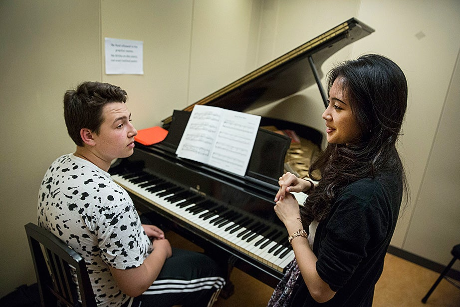 Lucy Nam works with eighth-grader Alex Sadock inside Paine Hall.