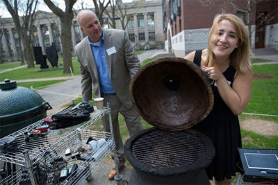 "After 220 pounds of brisket, 880 man-hours of smoking, and countless more hours of research, design, and construction in Kevin ""Kit"" Parker's ""Engineering Sciences 96"" class, the students appear to have pulled off the creation of a better barbecue. Parker (background) joins Jordan DeGraaf '16 during the final leg of the experiment."