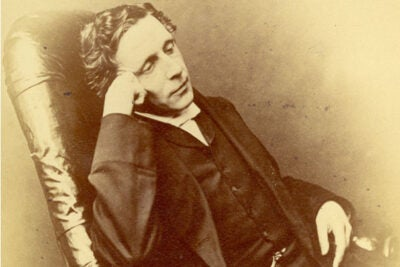 "Lewis Carroll (photo 1), author of ""Alice's Adventures in Wonderland,"" used his own funds for the book's first printing but recalled the original copies due to their poor quality. One rare remaining original copy  was bound in white vellum (photo 2) and presented to Alice Liddell in 1865. Laura Larkin (left, photo 3) and Julia Featheringill prepare to photograph the materials, which will be on display at Houghton Library starting May 20."