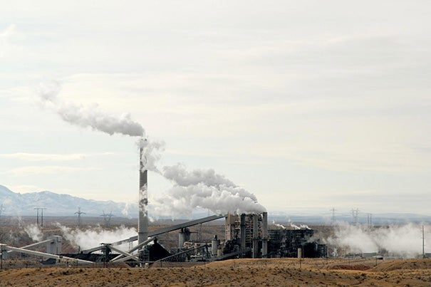 Power plants are the nation's largest source of the carbon dioxide emissions that contribute to climate change. Implementing power plant upgrades, as favored by some groups, would result in slightly lower air quality and modest adverse health effects, a recent study found. Pictured is a coal-fired power plant in Nevada.