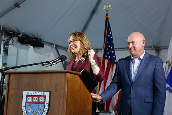 """Starting tomorrow, you can help change the world. The nation is counting on you, to create, to lead, to innovate,"" said Gabrielle Giffords. Giffords, a former congresswoman, and her husband, Mark Kelly, a retired Naval aviator, were the Class Day speakers at Harvard Law School."