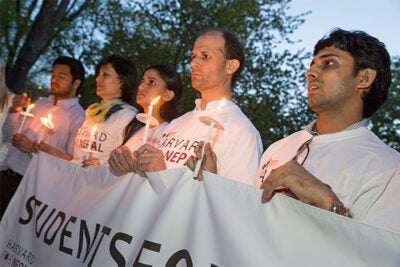 Harvard T.H. Chan School of Public Health doctoral student Elina Pradhan (second from left) was part of a candlelight vigil on the steps of the Memorial Church Thursday. Joining Pradhan, who has family in Kathmandu, were Muhammad Ferdaus (from right) of the Community College Initiative Program sponsored by the U.S. Department of State and Harvard Chan School students Xeno Acharya and Jigyasa Sharma.