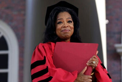"""AP photographer Elise Amendola said Oprah Winfrey """"was incredibly moved to receive an honorary degree. More so than I think I recall anybody else. And when she had the degree she clutched it to her chest and teared up. It just made for a beautiful picture."""""""