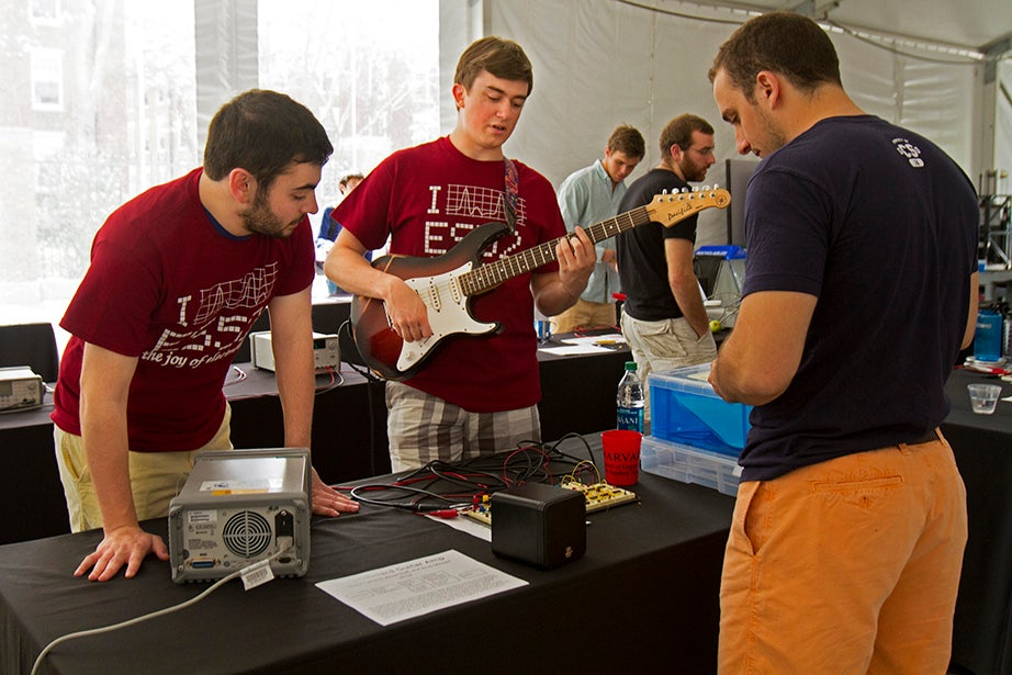 Brian Mendel '15 (left) and Ansel Duff '15 demonstrate the guitar amplifier they designed.